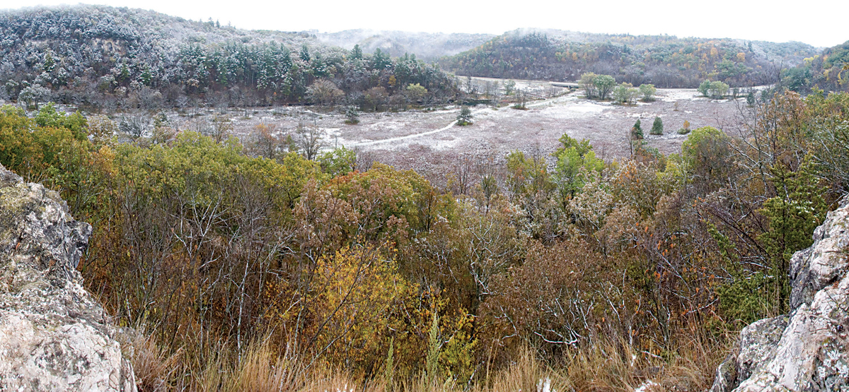 Panorama of snow on fall colors